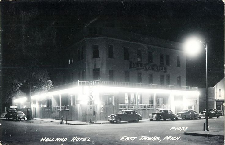 A Night View of the Holland Hotel, East Tawas MI RPPC 1956