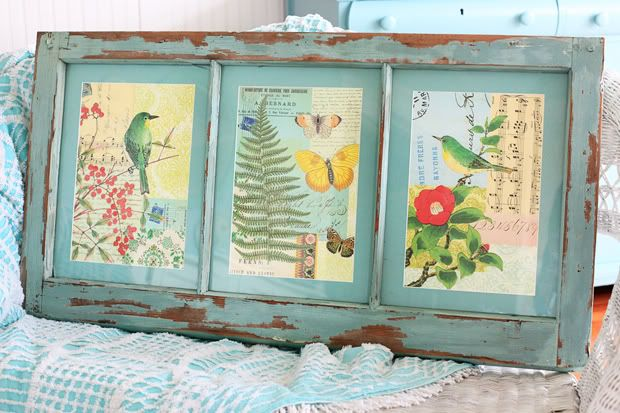 Calendar prints in a vintage window frame.