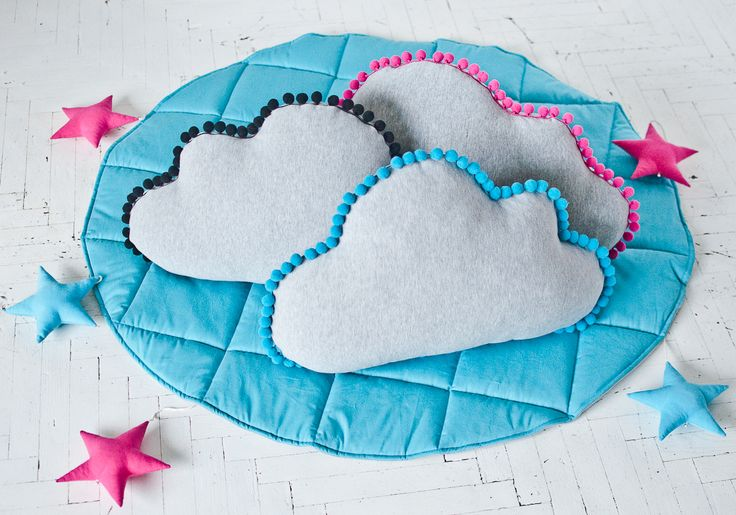Cloud pillows with pompoms and star hanging decoration