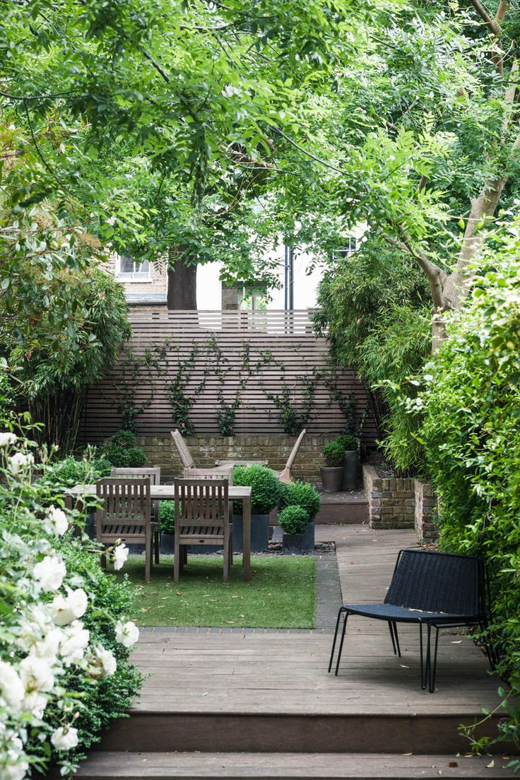 Garden: Lawn with table surrounded by hardscaping. A Clean Duplex in London | Rue