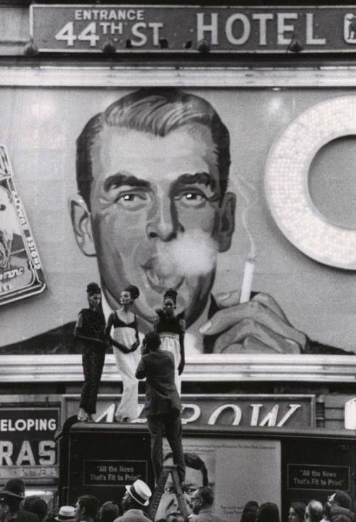 George W  Gardner :: Models posing at the Camel smoking billboard