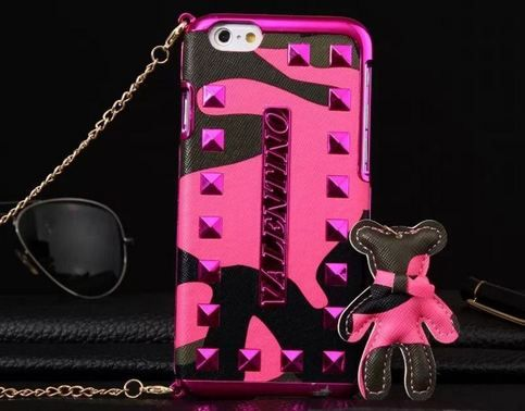 Show your style with this cute case  Iphone 6 or 6 Plus Choose from dark pink, yellow, light pink, orange, blue green  Detachable chain, stud details and Bear topper    Item is sent with Epacket to the USA and takes from 12- 15 business days to arrive  Other countries, this item will b...