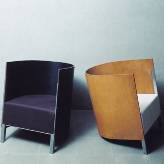 Maarten van Severen S88 Armchair. The curved leather will develop a patina with time.