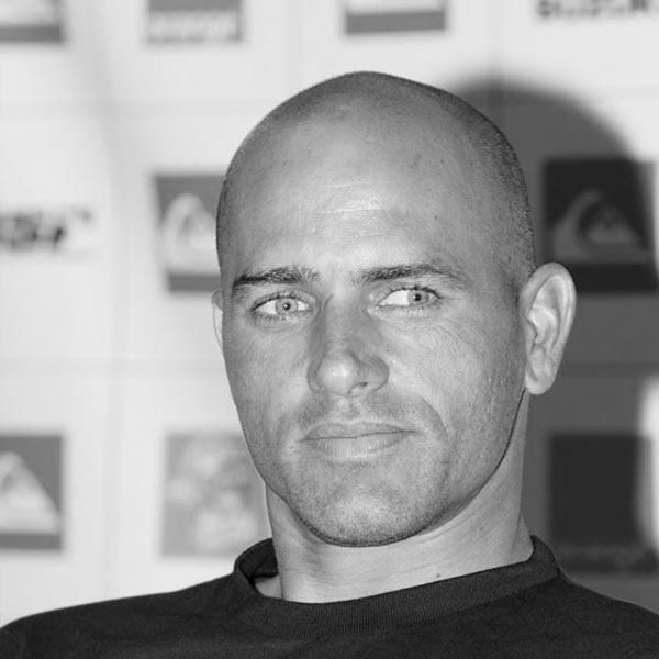 "Kelly Slater, the best surfer in the universe. Quote from a girl I met in a bar who met him, ""When you look in his eyes you see the mountains, the oceans, the sharks, the sun. Everything."" Haven't met him, but I love his tweets."