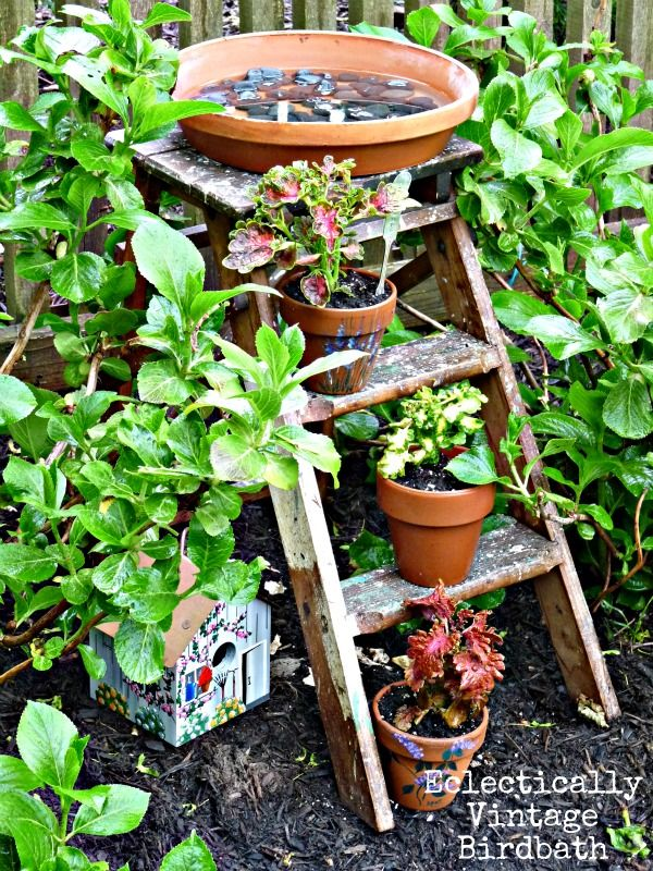 Great idea for a bird bath and I love the hand painted pot with a plant marker made from a silver butter knife.