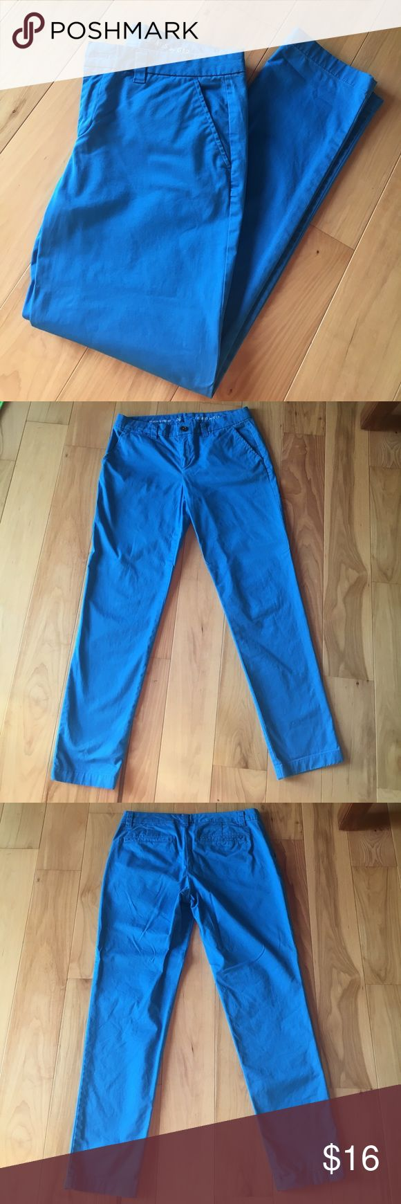 """Gap Broken-In Straight khakis in blue These khakis by Gap are a bright blue color.  There is one tiny stain, as shown in the last 2 pictures.  Inseam is just under 29"""".  Look great rolled up as capris too!  In great used condition.  From smoke and pet free home. GAP Pants Straight Leg"""