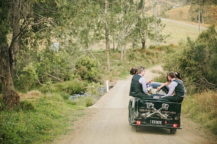 Taking a celebratory drive down the country road leading to Sarabah Estate Vineyard - a unique touch to a winery wedding!