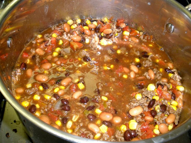 Southwest Soup  --  (aka Taco Soup)   ground beef, onion, taco seasoning, packet of dry buttermilk ranch dressing, pinto  and black beans, corn, and tomatoes.  Serve with tortilla chips or cornbread.
