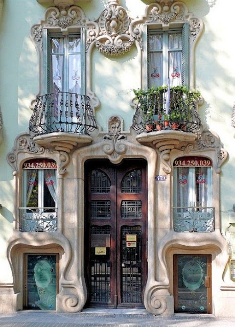 From Spain (perhaps Barcelona?). Gorgeous stone facade with Art Nouveau swirls and a bit of Gaudi inspiration. Image: Donna Levi, Pinterest.com: Doors, Building, Art Nouveau, Beautiful, Windows, Architecture, Places, Travel, Barcelona Spain