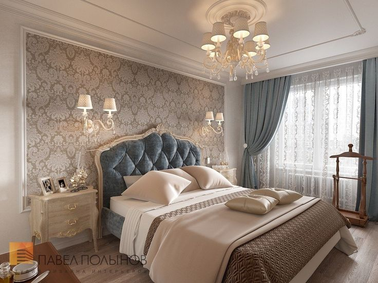 Beautiful bedroom with a luscious teal blue headboard. Lighting very appealing.