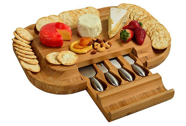 Malvern Deluxe Cheese Board Set on OneKingsLane.com This deluxe cheese-board set provides an extra large area for cheese and appetizers, making it great for parties. It also boasts a cracker serving tray around the entire cheese board, as well as a hidden drawer that stores four stainless steel tools. Lifetime warranty.