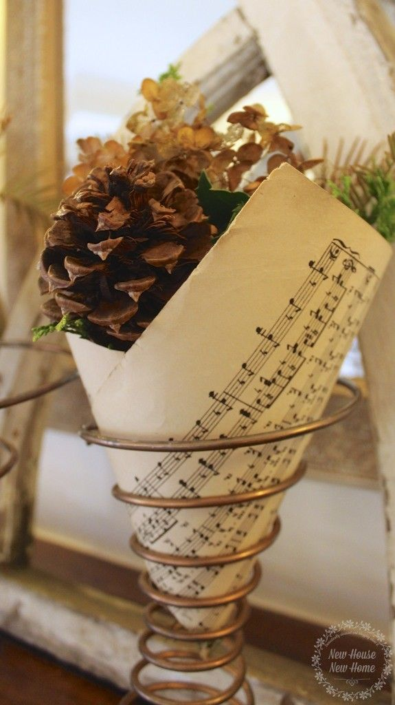 Turn an old bed spring into a sweet vase with vintage sheet music.