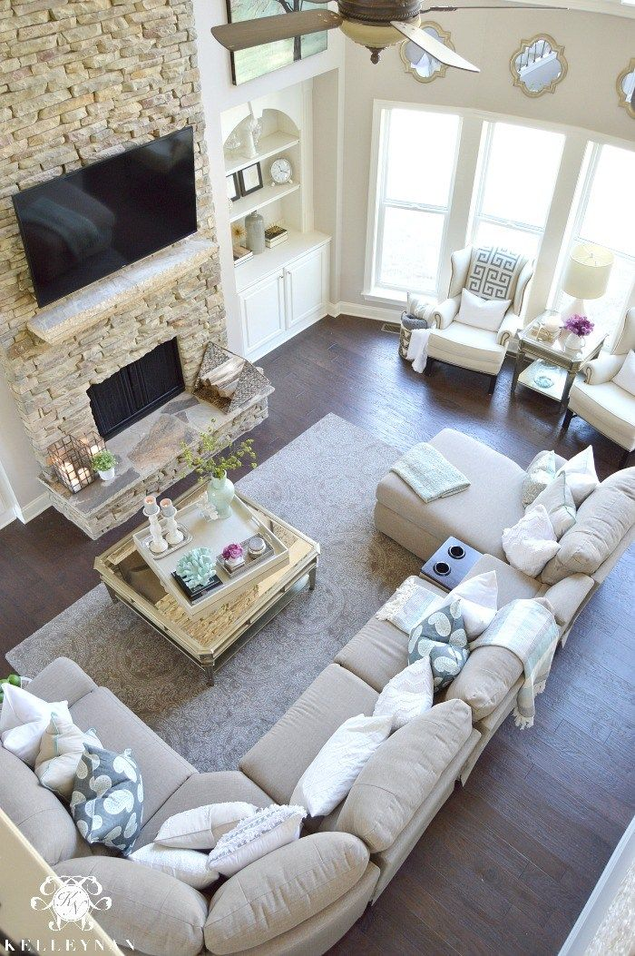 Two Story Living Room With Stacked Stone Fireplace And Built Ins Airy Elegant
