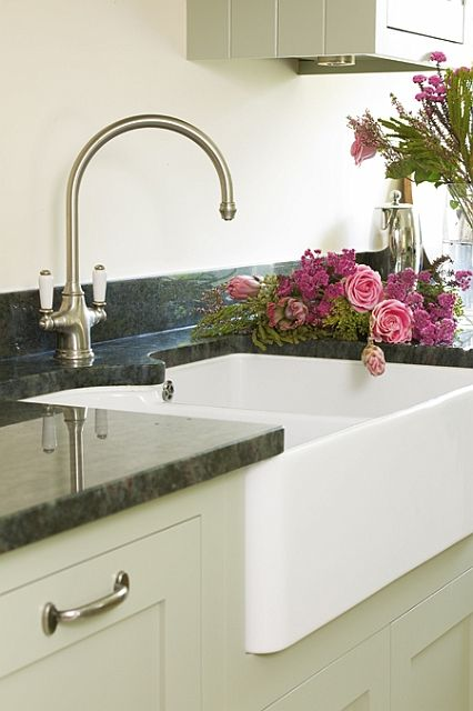 I think upstands are really smart and keep the worktop looking neat and not too overpowering. I think it is nice to leave the back wall painted if possible and an upstand can be a nice alternative to a splashback or tiles.