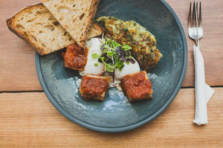 Twice cooked speck with feta, dill and zucchini fritter, poached eggs and tomato fondant served with sour dough at 161  #Pabloandrustys
