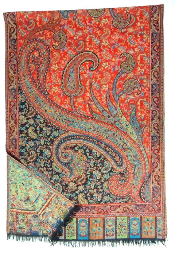 Living Rooms With Orange And Brown Paisley Print Pillows