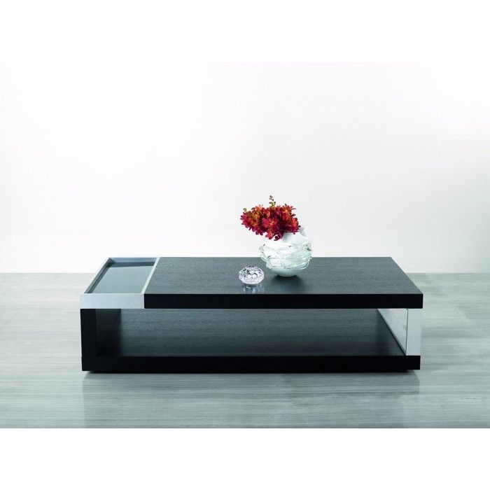 The asymmetrical balance of the Gemstone, which was created by aluminum accents placed on opposing sides, creates an interesting composition and visual appeal. Black tempered glass is inset amongst the aluminum accents on the top of the coffee table which establishes a sophisticated appearance. An open rectangular stainless steel leg is located on the opposite side of the table, contrasting nicely with the dark black oak finish. Open storage within the top and base contributes to the…