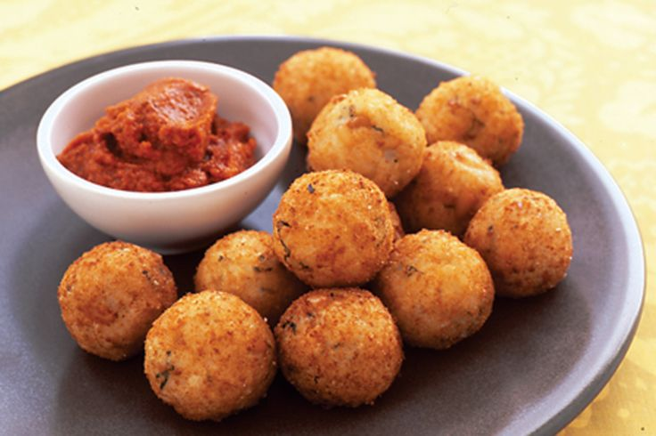 The strong flavour of sun-dried tomatoes are the perfect accompaniment to these cheesy arancini.