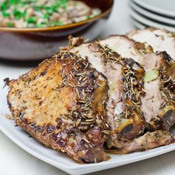Roast Pork with Rosemary and Garlic - perfect Sunday dinner. 3 – 5 lbs pork loin   1/4 cup olive oil 4 cloves garlic minced 4 cloves garlic cut in half 1/2 tsp chili flakes 1 tbsp dry rosemary salt and pepper to taste