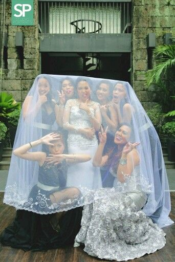 Me and my beautiful bridesmaids showing off our wacky faces under my veil