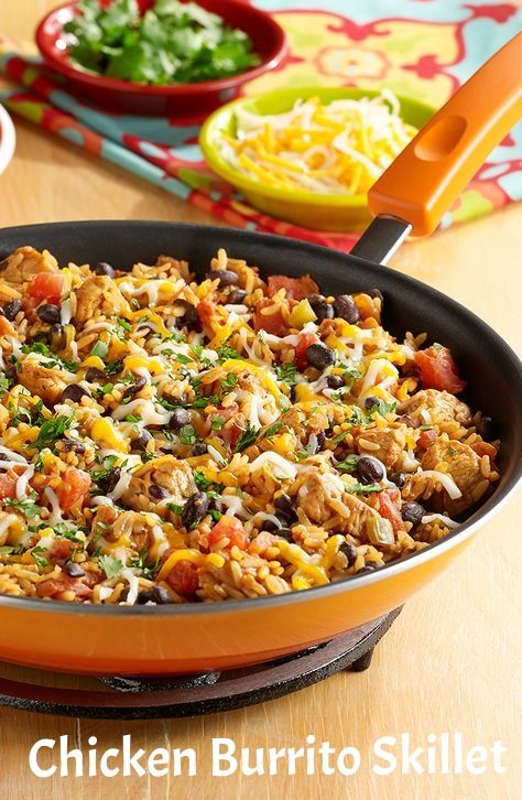Chicken Burrito Skillet - Chicken, black beans, zesty tomatoes and taco seasoning cooked together with brown rice for an easy burrito skillet topped with cheese.