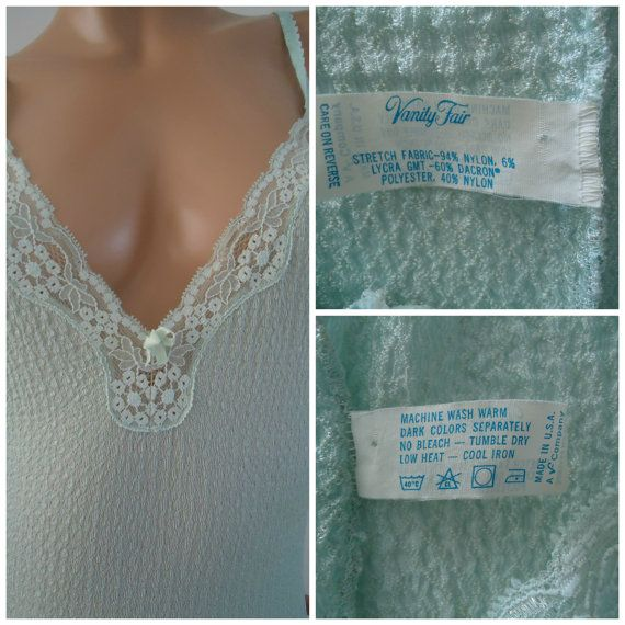 1960s Vanity Fair Long Nightgown Gorgeous vintage night gown with textured Honeycomb upper , uneven hem , aquamarine color Tagged S , length 50 Excellent condition Please check my other lingerie items you might like: https://www.etsy.com/listing/260220048/carnival-vintage-1960-nude-bustier-ilgwu https://www.etsy.com/listing/260121499/give-n-take-carnival-vintage-1960-nude?ref=shop_home_active_3 https://www.etsy.com/listing&...