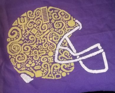 White Willow Stitching Tribal Football Helmet - Cross Stitch Pattern. Model stitched on your choice of 14 Count Aida with DMC floss. Stitch count: 199x157. Desi