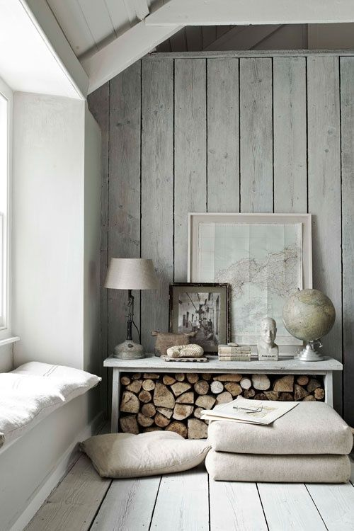 Firewood under a bench// Grey color palette//