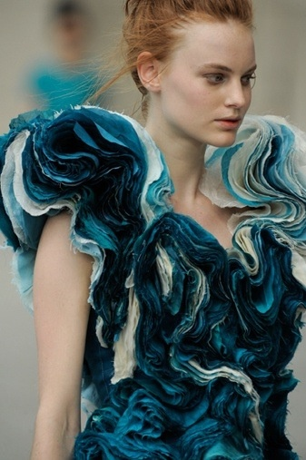 The different values of blue create a painterly effect, almost resembling water with the curves of the fabric. however, without the white adding some space, the garment would lose some of its depth
