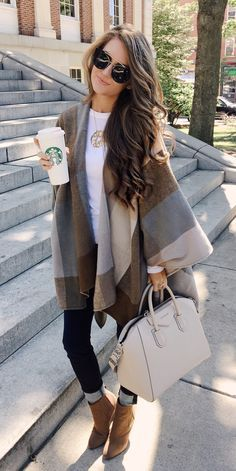 Poncho + jeans + boots+ Givenchy bag. Fall outfit inspo