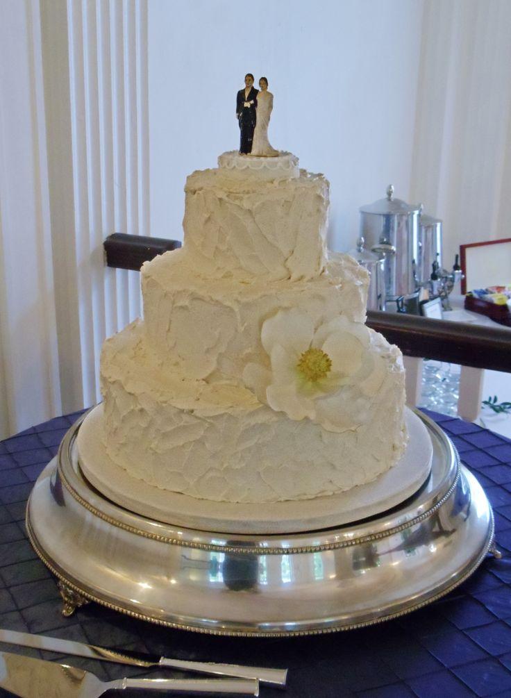 wedding cakes los angeles prices%0A Classic Three Tier Buttercream Wedding Cake with Handmade Sugar Magnolia  and Vintage Bride  u     Groom Cake