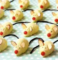 Christmas Mice Cookies: Children enjoy helping to make these no-bake cookies, which are similar to a macaroon-somewhere between a cookie and a candy. Green (sour apple) candy whips, also called laces, make nice mouse tails. You can also use red or black licorice whips, or any color or flavor you like.