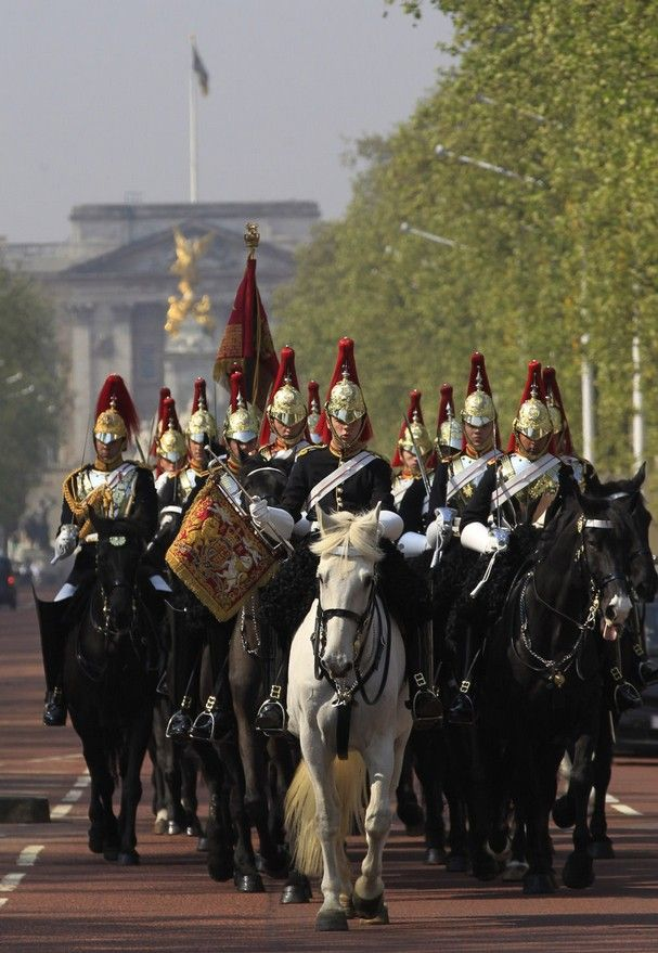 The Blues & Royals of the Household Cavalry Mounted Regiment ride along the Mall, backdropped by Buckingham Palace, in London on their way to Horse Guards Parade, on Thursday, April 21, 2011. The Blues & Royals together with the Life Guards will form a Sovereign's Escort for Queen Elizabeth II and a Captain's Escort for the bride and groom from Westminster Abbey to Buckingham Palace during the royal wedding of Prince William and Kate Middleton on April 29.