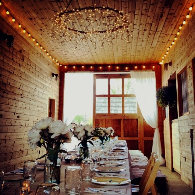 Barn decor for the wedding rehearsal dinner - Wood all around, Sheer  drapes, wreath