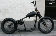 Malibu Cycle Works Rolling Bobber Chassis, custom tank, ape hangers, springer front end, and oil tank.