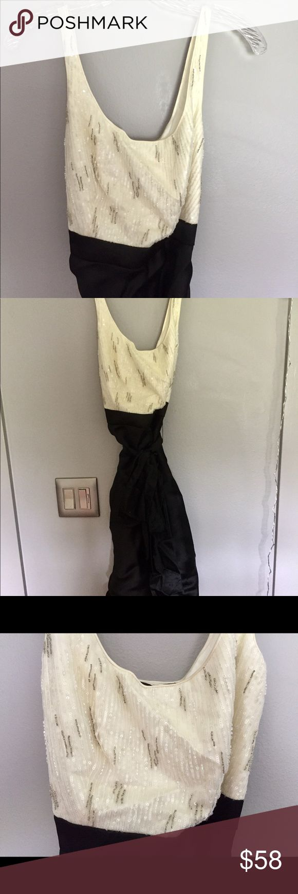 """""""Carmen Marc Valvo"""". Black and white dress """"Carmen Marc Valvo"""" black and white cocktail dress. Size: 8. Worn once, like new. 39 inches from top of sleeve to hem of dress. Top is beaded with sequins. Zipper on side of dress. Carmen Marc Valvo Dresses Midi"""