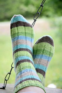 Knitting these socks right now. Easy-peasy pattern, different enough from a plain sock to add interest without adding hassle! I've knit these twice and they make me smile just looking at them.