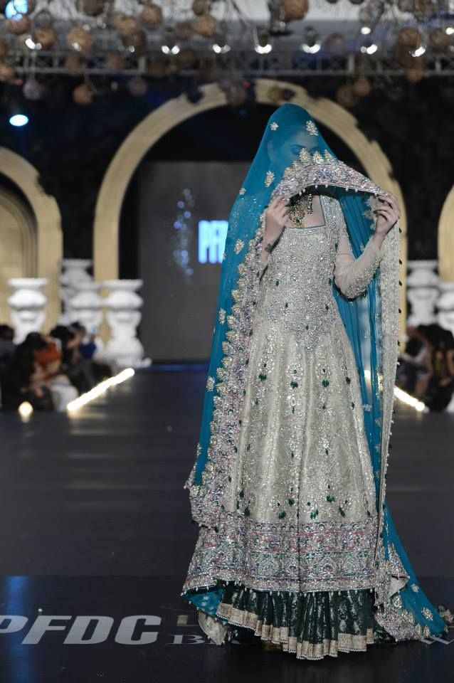 Ali Xeeshan  Love the color of the offwhite kameez