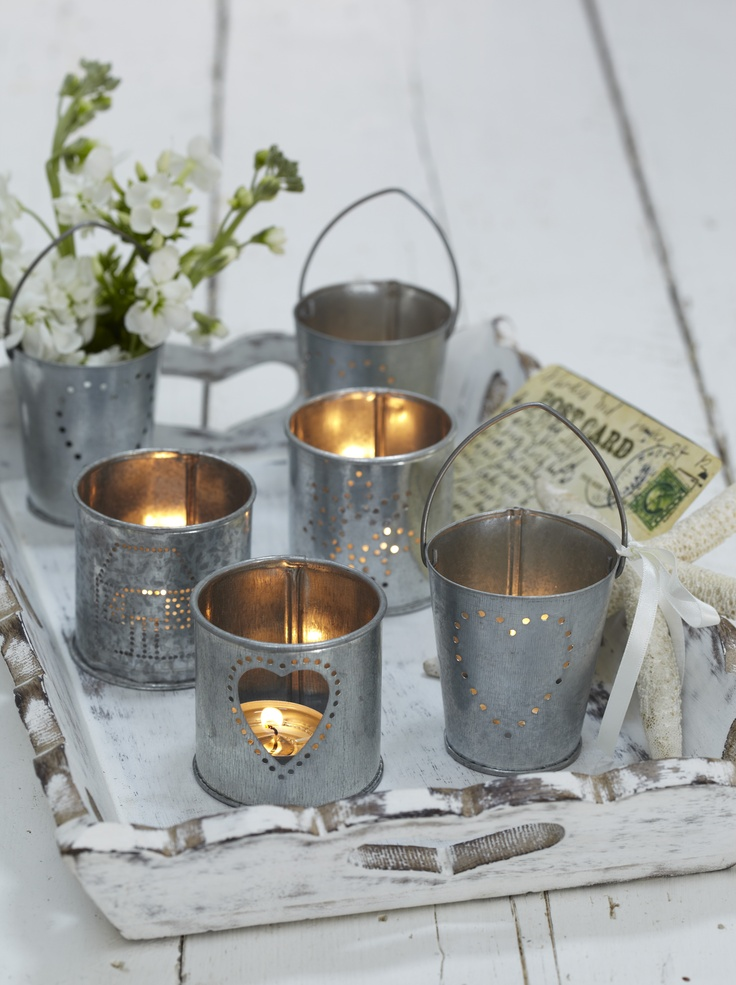 Sweet little tealight holders for Spring in galvanised steel, pierced to let the light glow through