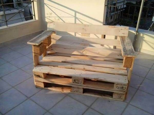 outdoor seating Bench becomes couch with little amendments and here we used extra lumber to craft our desired two-seater by re-transforming old retired wood pallets. The wider arm rests can easily accommodate your coffee and magazines.