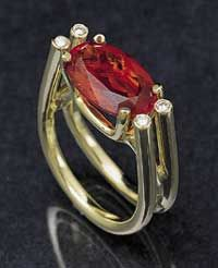 Ring | GJ Designs.  18k green gold ring is set with a Mexican fire opal and four diamond accents