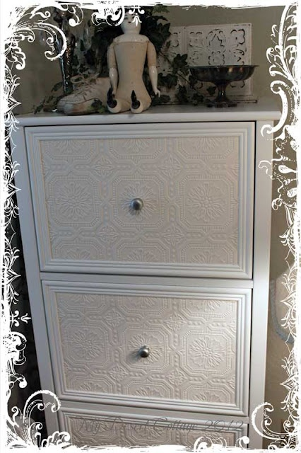 would like to redo a filing cabinet like this .........maybe with embossed paintable wallpaper and glue molding around the drawers......hmmm.