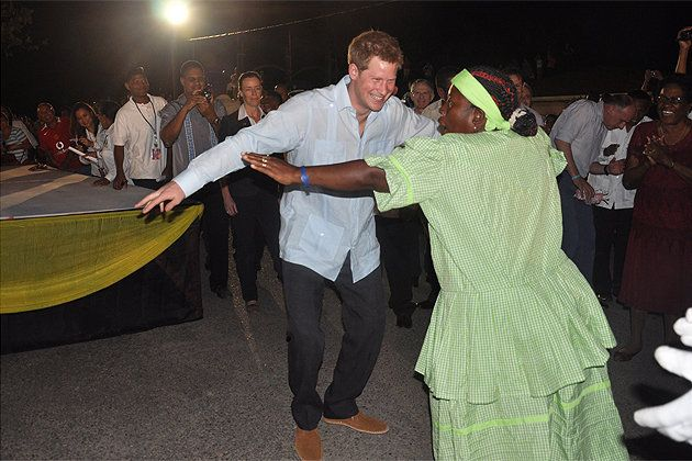 Prince Harry Dances Punta with Garifuna woman - Photo by Jamil Loskot