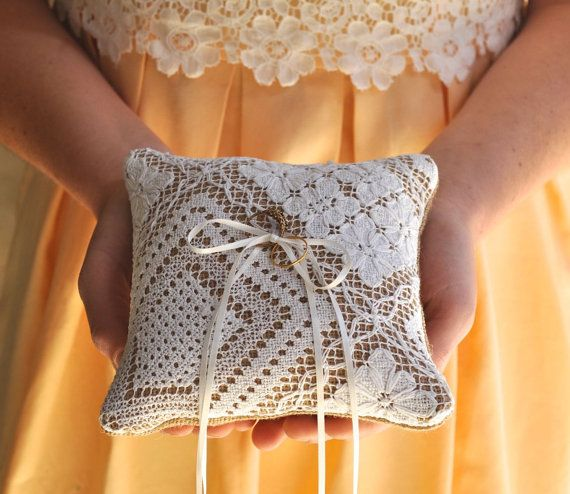 Delightful ring bearer cushion made from hessian/burlap with an edging trim of vintage hand made filet lace.   2 strands of ivory ribbon and 2