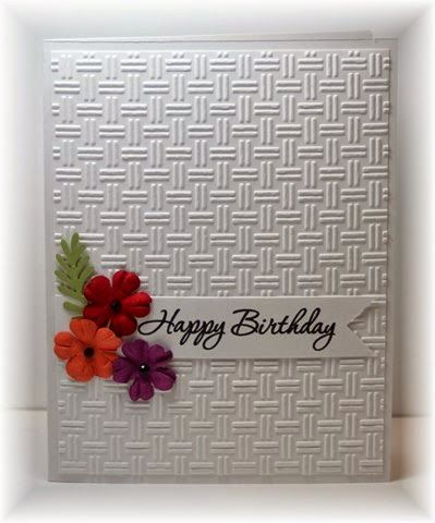 The card - some prima flowers, a punched leaf, a sentiment on a banner and an embossed background (from Hobby Lobby).  Pretty darn eas...