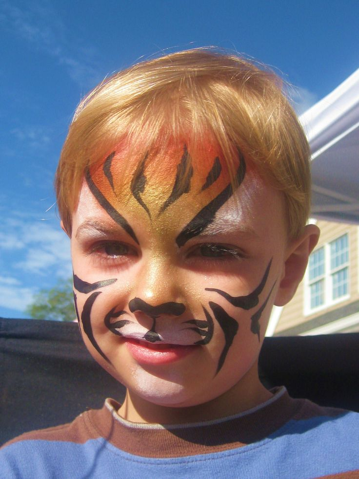 face painting designs easy | boy with tiger face paint