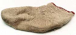 """Norse socks were not knitted, which apparently was unknown to the Norse. Instead, they were made using an ancient technique called nálbinding (needle-binding). Using a single large, thick needle, it was a method of knotting the yarn. Although time consuming, this approach resulted in a nearly indestructible garment. If the thread were to break or wear out, the garment would still be intact, since the thread was everywhere knotted to neighboring threads."" This sock found in York."
