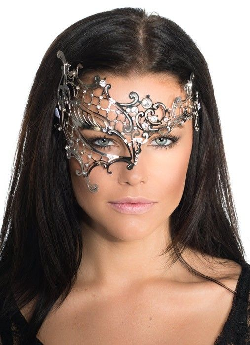 Divine women's half face silver metal masquerade mask by Elevate. This top quality women's silver metal masquerade mask features a laser cut filigree design with sparkling crystals to decorate, ideal for any elegant masquerade mask party. See below for full description.