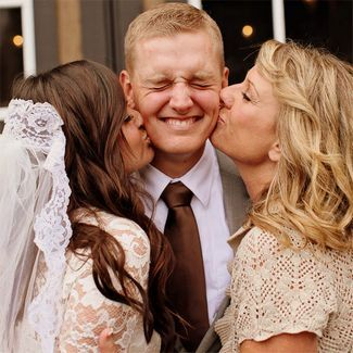 Sweet photo of the groom with his two favorite ladies — his bride and his mom! Do also with bride and her dad and groom. I want a picture like this!
