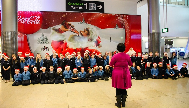 Children from Scoil Bhride, Donaghmede singing in Terminal 2.
